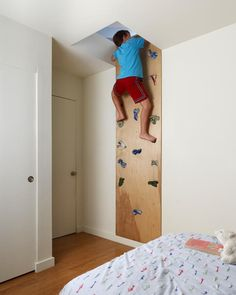 This climbing wall by Feldman Architecture allows a child to climb to the next floor.