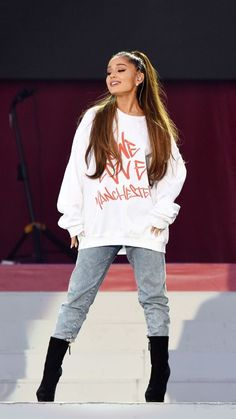 ca0d74a09747 Spott - Ariana Grande performing wearing a White sweatshirt Denim Jeans and Black  Boots