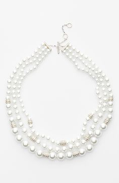 Love the sparkly crystal detail on this faux pearl and gold necklace.