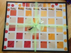 DIY Calendar made from paint chips. Makes a great gift! This one is for a graduate gift.
