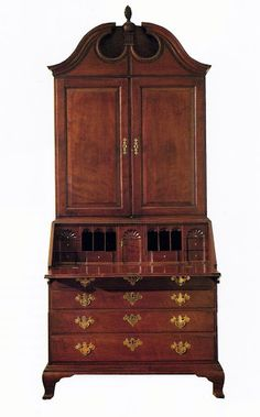 Chippendale mahogany secretary-desk ascribed to John Townsend, Newport, Rhode Island, circa 1760-1780 (made for Jonathan Nichols, who owned the White Horse Tavern). The stature of American furniture does not always depend on ornament or motifs. From the standpoint of perfect proportion, design craftmanship, and original condition & surface, this secretary ranks among the great Newport productions. Comparison of this interior to the labeled John Townsend desk proves its authorship.