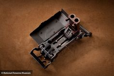 This Marquis Nazi belt buckle pistol is one of the great weapons rarities of World War II. Its dropping front plate exposes twin cal barrels that are ready to fire. Concealed Carry Weapons, Steampunk Weapons, Lever Action, Outdoor Survival, Firearms, Belt Buckles, Hand Guns, Inventions, Antiques