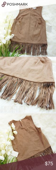 NWT 1 State Faux Suede Fringe Top   Size  XS Urban Frontier Top by 1. State is perfect for festival or country concert! This top brings fun to any occasion. Pair it with your favorite denim shorts/skirt and accessories! 87% poly , 13% spandex Dry clean only Back snap button closure Fringe trim MSRP: $128.00 1. State Tops Blouses