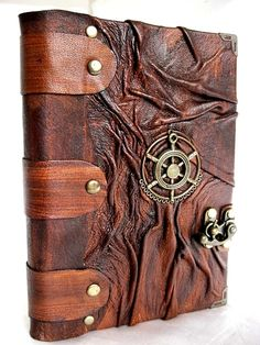 Luxury handmade vintage look blank leather journal notebook with Steampunk emblem. $49.99, via Etsy.