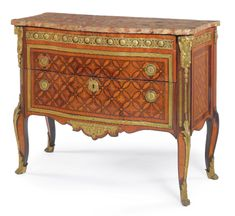 A LOUIS XV/XVI TRANSITIONAL ORMOLU-MOUNTED TULIPWOOD, AMARANTH AND PARQUETRY COMMODE Circa 1765, stamped P. DENIZOT