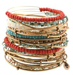 Stackable bracelets in earthy tons; love everything about this, especially paired with jeans and leather sandals. <3 <3 <3