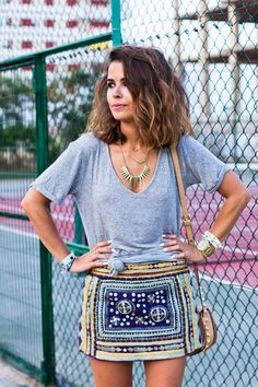 Grey tee, embellished mini & stacked jewellery. Easy boho glam spring style.