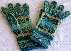 Ravelry: sweatergoddess' Cunningsburg Star Gloves.