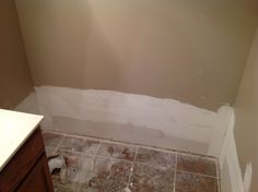 Replaced damaged Sheetrock at bottom of bathroom wall