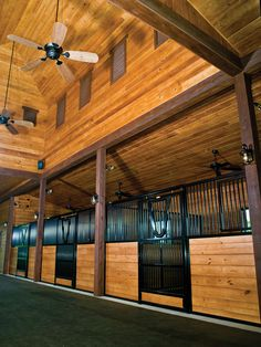 Center entry stall fronts with yoke opening and vertical wood fill bottom. #classicequine #CEE #besthorsestalls