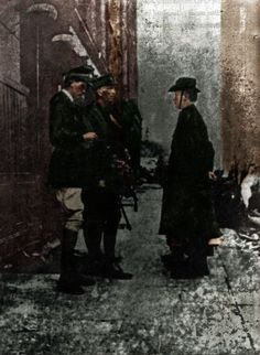 16 Apr, 2.30pm: Pearse in his heavy military overcoat & slouched hat, marched towards the barricade, Elizabeth O'Farrell by his side. He was received by General Lowe, surrendering his sword, pistol & ammunition. Outside of Byrne's shop at the corner of Moore St an old wooden bench was brought out for Pearse to sign the document of surrender. Ms O'Farrell was to deliver the documents of surrender to various Dublin outposts. Without speaking & with a smile he grasped her hand for the last…
