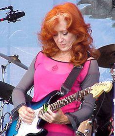 Bonnie Raitt plays slide guitar