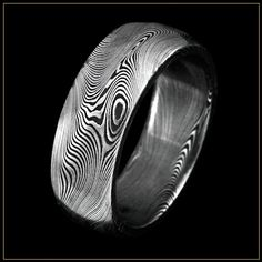 (8) Damascus Stainless Steel replicate the strength and subtle beauty of the ancient swords handcrafted by artisans over a thousand years ago. Damascus Steel radiates the power required to forge them and the strength that makes them so durable.  Each ring is distictive as the individuals who wear them. Damascus Steel is a contemporary metal that represents a stylish alternative to titanium. All of our Damascus Steel rings are made from corrosion-resistant stainless steel and are 100%…