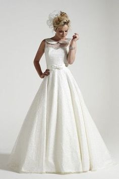 This collared a-line gown by Sassi Holford is perfect for the preppy bride!
