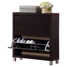 Are you really into shoes? 25-Pair Shoe Storage Cabinet offers the answer for style-conscious individuals whose space is at a premium. With such sharp, American styling, you won't be forced to stow your footwear in an upstairs closet. Three slatted front doors feature sturdy solid-wood handles and the subdued espresso finish permits placement in more ornate surroundings.
