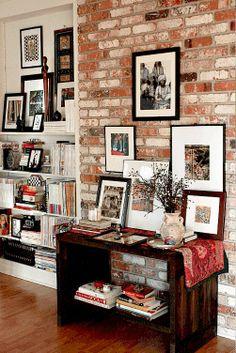 brick wall with various photo displays