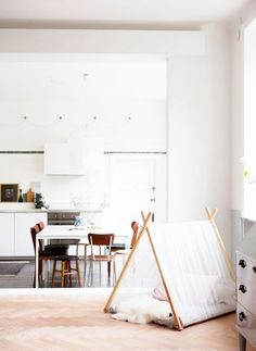 Bright white kitchen with wood details and teepee
