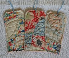 This is a cheerful shabby set of 3 manila gift tags with vintage to antique cutter quilt, fabrics sewn onto them. This set include three large