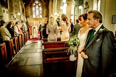 Bride and Father going down the isle while the groom waits....Exeter Wedding by Grant Stringer
