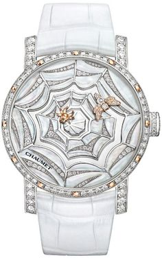 Chaumet Montre Precieuse 'Attrape-moi... si tu m'aimes' rhodium-plated watch in white gold, set with 64 brilliant-cut diamonds (1.64ct) and 12 polished pink gold indexes. The bee indicates the minutes and the spider the hours.