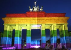 23 Of The Most Powerful Photos Of This Week- The Brandenburg Gate in Berlin, Germany, is seen with a rainbow flag projected onto it during a vigil for victims of the Pulse nightclub massacre.