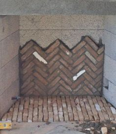 Tim Grant, from Superior Masonry Builders, is installing the antique firebrick in a herringbone pattern. The firebrick will be much lighter when it dries.