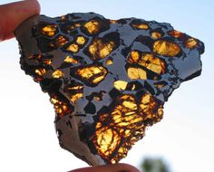 Pallasite Meteorite...well, maybe Earth didn't make it, but Earth received it, and it became as such is seen here!