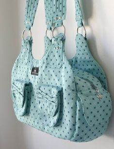 """Handbag PDF sewing PATTERN *ABIGAIL* Finished bag size = Approx. 41cm (16"""") X 18cm (7"""") X 11.5cm ( 4½"""") Difficulty = ADVANCED - This pattern is PERFECT if you are looking for something a little more challenging and just that little bit different! It is time consuming to make though, so I do NOT recommended this pattern if you are looking for a quick project! ============================================================ FEATURES: The Abigail handbag/purse features all the pockets you need to…"""