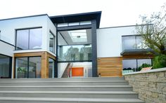Incorporating unique glass elements into an eclectic new build – using double height guillotine windows this home made an impact.   The middle pane of 3 is fixed, with the other 2 panes sliding towards each other in a guillotine fashion to reveal bright open spaces.   Check out the full case study for all the details. Sliding Windows, Sliding Doors, Frameless Glass Balustrade, Indoor Outdoor Living, Outdoor Decor, Living Environment, Open Spaces, Window Design, New Builds