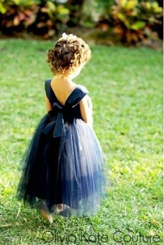 Sweetest navy blue flower girl dress! Check out our Pinterest for more wedding inspiration: http://bit.ly/vow-pinterest