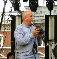 Peter Gabriel plays with his camera during a soundcheck, ca. 2007