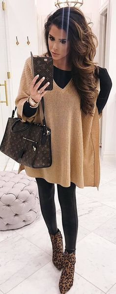 #winter #outfits beige knitted poncho, black shirt, leather leggings, panther boots
