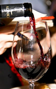 red wine being poured into wine glass #photo