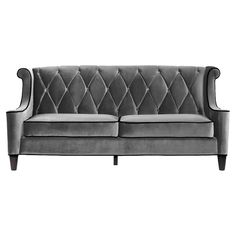 Tufted sofa with velveteen upholstery