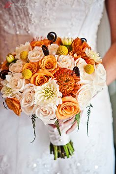 Fall Wedding Bouquet, would be very beautiful with the purple theme...would stand out from the rest and if you added a few lilac flowers into the arrangement...so pretty!