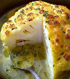 Ingredients 1 head of cauliflower Fresh thyme 2 bay leaves 4 cups (1l) vegetable or chicken stock, more or less, depending on the size of the cauliflower 1/3 cup (70)g melted butter Fresh cracked pepper Directions 1. Preheat your oven to 400ºF (200°C).