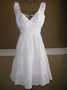 white sun dress! I love this. I can't wait til I can pull a dress like this off!