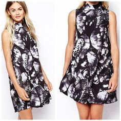 """High Neck Swing Dress in Butterfly Print Worn a few times. Length is approx 34"""" and bust is approx 36"""" laying flat. 95% polyester and 5% elastane. High funnel neckline. Made from a stretch jersey. Gentle pleating. Regular fit. All over butterfly print. ❌NO TRADES❌ ASOS Dresses"""