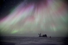 A shower of auroras seems to be pouring down onto the South Pole Telescope (SPT) at Amundsen-Scott South Pole Station Photograph by: Sven Lidstrom National Science Foundation Dark Sector, Open Source Images, Aurora, Cosmic Microwave Background, Dark Energy, Photo Library, Night Skies, Amazing, Antarctica