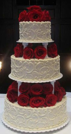 3-tier wedding cake with red roses--add a black ribbon to the base of each layer and that's our cake!