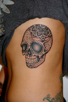 sugar skull tattoo - cool but too big.  Could be easily altered to sunglasses and instead of the flower I would have the skull filled in like the rest and a bow added