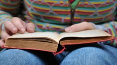 Image result for book in hand