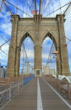 Take a walk or drive down Brooklyn Bridge, an iconic landmark in New York City.