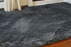 "College Plush Rug  Top Features include:  Softest Dorm Rug! Seriously the SOFTEST! 1.25"" high thick plush, free flowing strands Anti-slip gel bead bottom / Side Tapering Machine Washable & Vacuum Friendly"