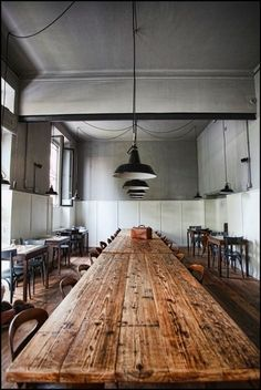 Beautiful reclaimed wood table and antique lighting fixtures.