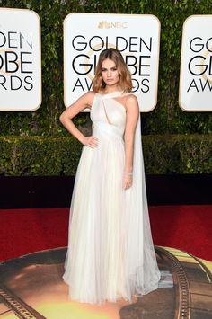 "Lily James in Marchesa at the Golden Globes: I don't even know how Georgina Chapman managed to do this, but it looked as though white water was cascading down from James's shoulders to her toes at this year's Golden Globes. This is something I'd imagine that Arwen from ""Lord of the Rings"" would wear. —Gemma. Photo: Jason Merritt/Getty Images."