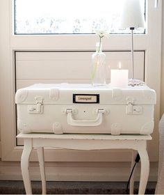white suitcase table