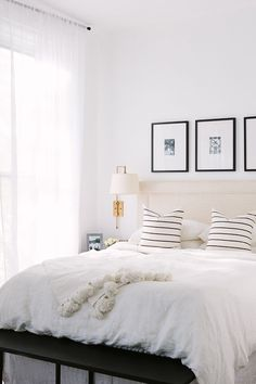 Framed photos above the bed inside Cofounder Alaina Kaczmarski's Greystone Home Tour | The Everygirl