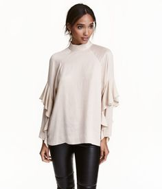 Light beige. CONSCIOUS. A-line blouse in lightly crinkled satin. Stand-up collar, opening at back, covered buttons at back of neck, and long raglan sleeves