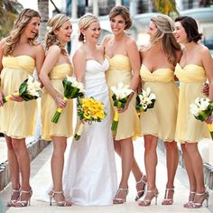 this yellow bridesmaid dress with an orange flower would be pretty in september or october
